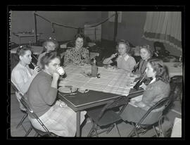 Marylhurst College students at table, drinking soda, 1943?