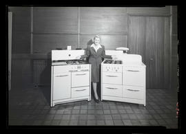 Hegeberg? posing with pair of stoves