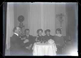 Five unidentified people at table