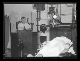 Technician and patient with X-ray machine