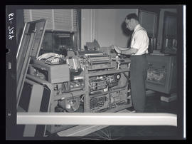 Man working on accounting machine