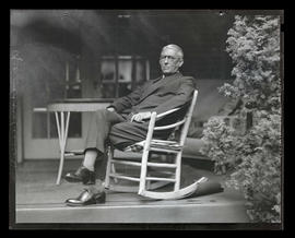 General Andrews, seated in on porch