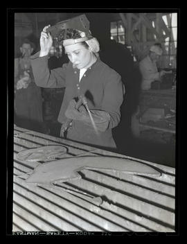 Welder Jeannine Christensen holding blowtorch, Albina Engine & Machine Works, Portland