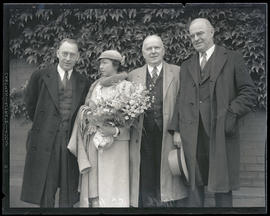 Earl C. Mills with Mrs. C. C. Hall and two unidentified men