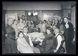 Group of unidentified people at birthday party