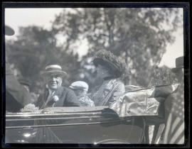 President Warren G. Harding and First Lady Florence Harding, riding in car during parade in Portland