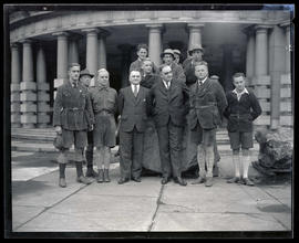 George L. Baker and group of men posing with large rock outside Portland City Hall