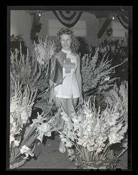 Costumed young woman with flower display