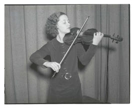 Girl holding violin and bow