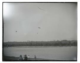 Parachutist over river