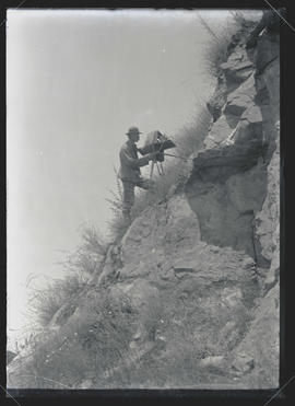 H. T. Bohlman Photographing a Vulture's Nest