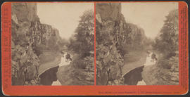 """Rock Bluffs west from Tunnel No. 3, Col. River Scenery, Oregon."" (Stereograph E18)"