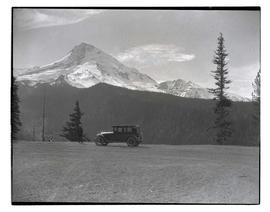 Oregon Journal car on Cloud Cap Road with view of Mount Hood