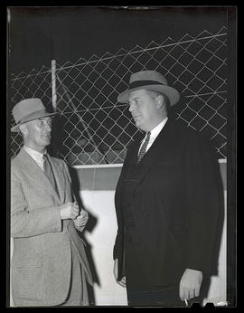 Two unidentified men, probably at Pacific International Livestock Exposition