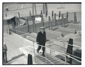 Commander Louis J. Gulliver walking up gangway to USS Constitution