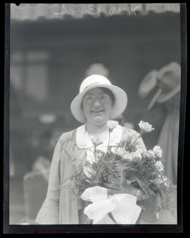 Mrs. Bird, holding bouquet