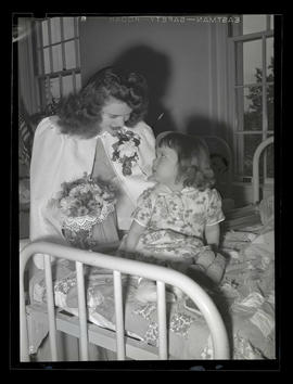 1942 Portland Rose Festival princess visiting patient at Shriners Hospital?