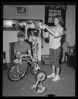 Decorating a tricycle for the Junior Rose Festival Parade