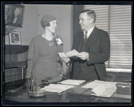 Portland Mayor Joseph K. Carson and unidentified woman in mayor's office