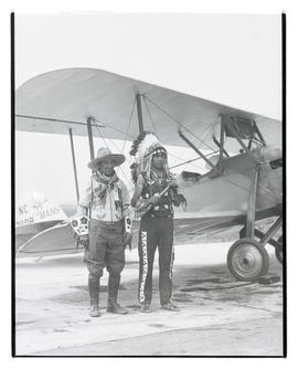 Kiutus Tecumseh and his father next to plane at Swan Island airport