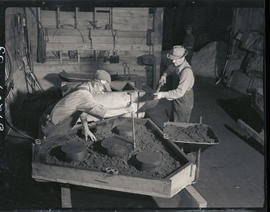 Packing sand into a mold at Columbia Steel Casting Company