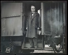 Senator George W. Norris of Nebraska, standing on steps of train car