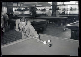 Gus Cupola, playing billiards
