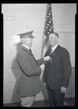 Brigadier General Paul A. Wolf presents Distinguished Service Cross to Helmuth B. Dewitz