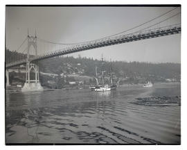 USS Constitution and tugboat sailing under St. Johns Bridge