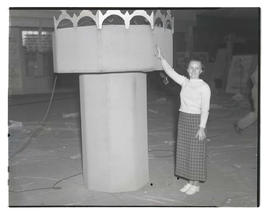 Unidentified woman with turret-shaped prop, probably at Pacific International Livestock Exposition
