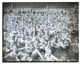 Crowd of children in outdoor pool