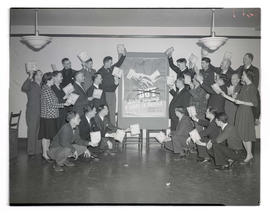 Portland Gas & Coke Co. employees posing with defense bonds and poster