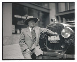 J. M. Schwoob, posing with vehicle