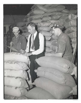 Unidentified men with sacks of supplies