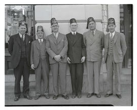 Six members of Al Kader Shriners posing outside Oregon Journal building