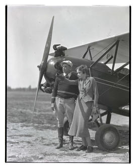 Pilots Dorothy Hester and Tex Rankin next to biplane