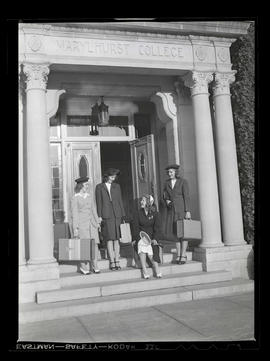 Four Marylhurst College students outside administration building, opening day, 1943?