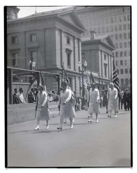 Women with flags walking in parade