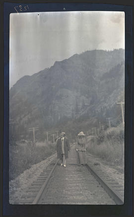 T. Gilbert Pearson and woman on railroad tracks