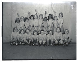 Children, possibly dancers, in matching outfits