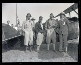 Thomas Colby, Charles W. Meyers, Bill Baldwin, and unidentified man next to plane
