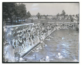 Crowd of swimmers at outdoor pool
