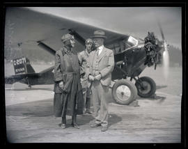 Mrs. D. W. Barnes with two men on day of her first airplane flight