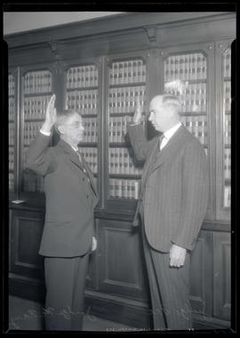 Judge John H. McNary swearing in James Alger Fee as federal jurist