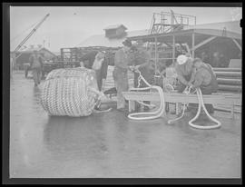 War industry workers with spools of rope at Albina Engine & Machine Works, Portland