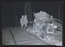 Wrecked car next to railroad tracks