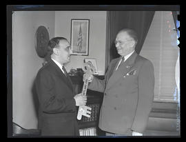 Portland Mayor Earl Riley presenting Brazilian Consul Adolpho de Camargo Neves with key to the city