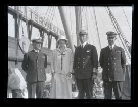 Woman with three U. S. Navy officers aboard ship in Portland?