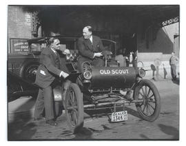 "Mayor George L. Baker and unidentified man with an Oldsmobile ""Old Scout"""