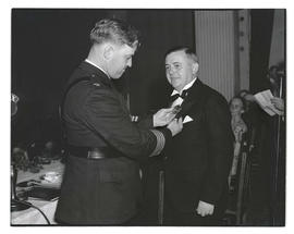 Joseph K. Carson receiving badge from Portland police officer?